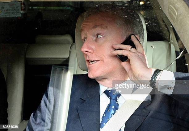 Sir Fred Goodwin ChiefExecutive Officer of the Royal Bank of Scotland speaks on his mobile phone as he leaves the Edinburgh International Conference...