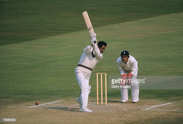 Sir Garfield Sobers of the West Indies bats while Alan Knott of England waits behind the wicket during a match at the Kennington Oval in London...