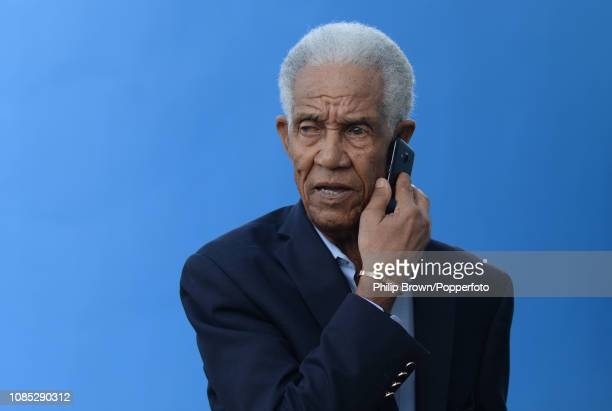 Sir Garfield Sobers speaks on the phone during a West Indies training session at Kensington Oval on January 19 2019 in Bridgetown Barbados