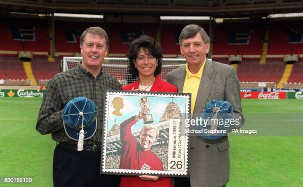 Sir Geoff Hurst Stephanie Moore and Martin Peters at Wembley Stadium London to unveil the latest Royal Mail Millennium Stamp The stamp pays tribute...