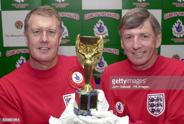 Sir Geoff Hurst the hattrick scoring hero of the 1966 World Cup final and the other goal scorer Martin Peters with a replica trophy at the launch of...