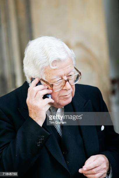 Sir Geoffrey Howe former Conservative Foreign Secretary chats on his mobile phone outside St Paul's Church in Knightsbridge after a memorial service...