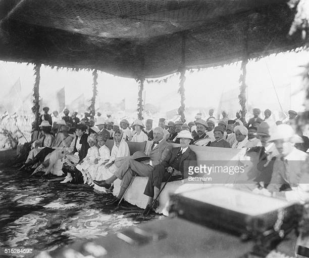 Sir George Lloyd party is shown at the pavilion The two young brothers of the Maharajah are seated next to Lady George Lloyd