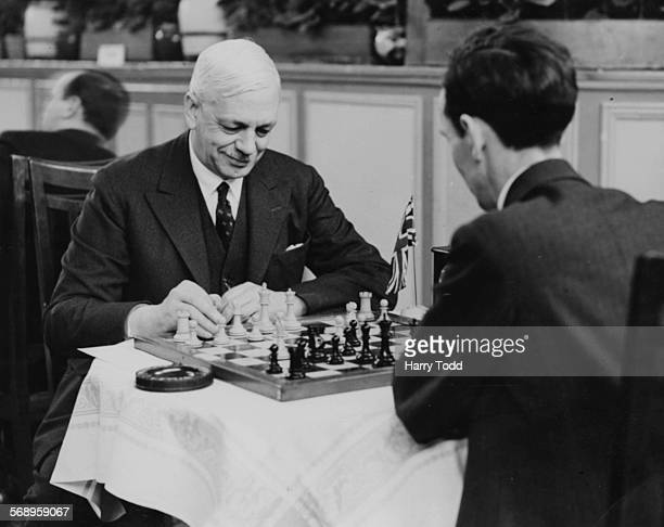 Sir George Thomas leader of the British chess team playing Irishman Brian Reilly at the Easter Chess Congress Margate April 24th 1935
