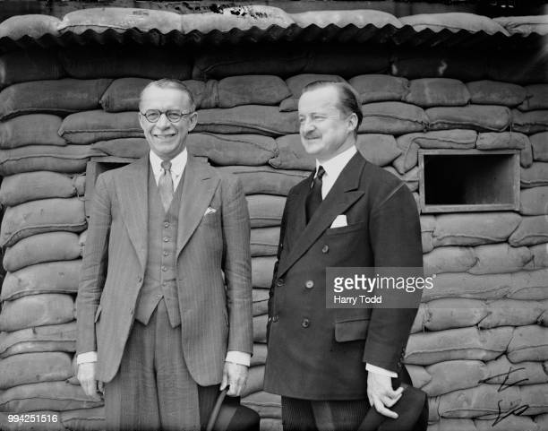 Sir Gerald Campbell , Director of British Information services in the US, visits Duff Cooper at the Ministry of Information during a trip to London,...