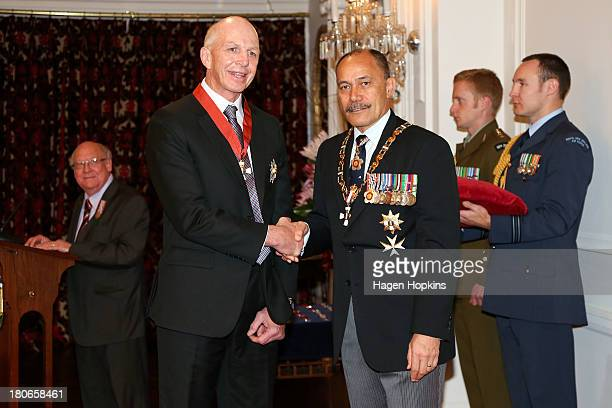 Sir Gordon Tietjens receives a knighthood and the Insignia of a Knight Companion of the New Zealand Order of Merit from GovernorGeneral Sir Jerry...