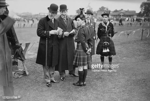 Sir Guy Granet and Mr George Hughes attend the LMS Railway's athletic meeting at Wembley in London, June 1923. Granet, the left of the two men in...