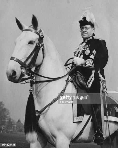Sir Harold Richard Scott, KCB, KBE , Commissioner of the Metropolitan Police, mounted on Angela, the grey mare which will carry him to Westminster...