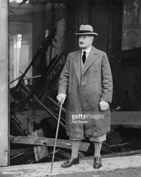 Sir Henry Buckland general manager of the Crystal Palace on Sydenham Hill southeast London stands amidst the ruins after the building was destroyed...