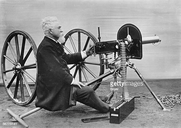 Sir Hiram Stevens Maxim inventor and British industrialist of American origin with a machine gun of his invention BOY 6986