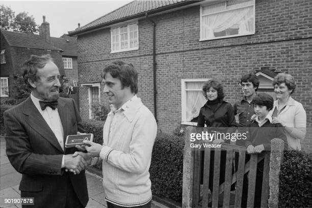Sir Horace Cutler leader of the GLC presents a golden key to Mr Hannen the first GLC tenant to buy his own house since the GLC reopened the scheme...