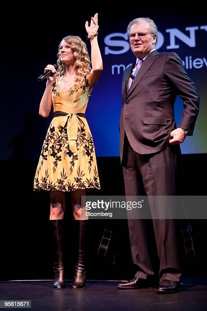Sir Howard Stringer chairman chief executive officer and president of Sony Corp right welcomes recording artist Taylor Swift during the 2010...