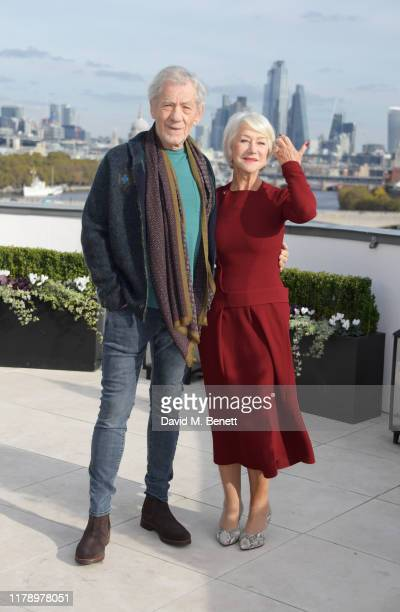 Sir Ian McKellen and Dame Helen Mirren pose at a photocall for The Good Liar at The Corinthia Hotel London on October 30 2019 in London England