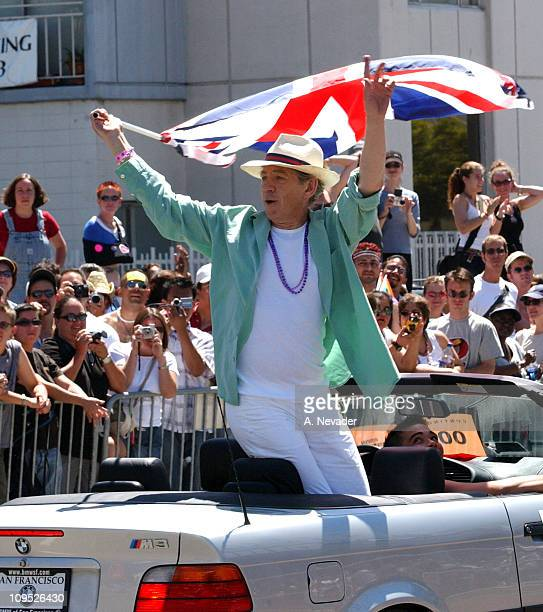 Sir Ian McKellen as Grand Marshal waves a UK flag as he leads the 32nd Annual San Francisco Gay Pride Parade
