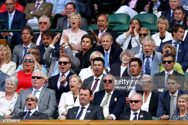 Sir Ian McKellen Dame Maggie Smith Sir Chris Hoy Hideki Matsuyama and the Duke of Kent react in the centre court royal box during the Gentlemen's...