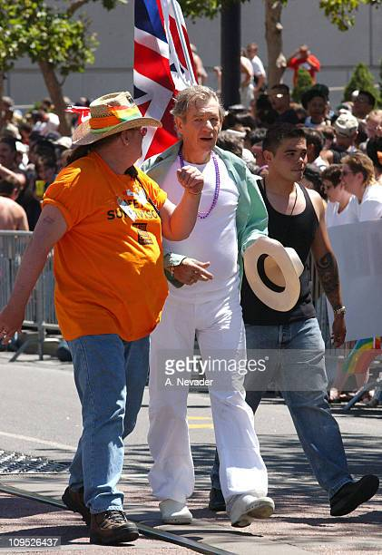 Sir Ian McKellen holds a UK flag as Grand Marshal of the 32nd Annual San Francisco Gay Pride Parade