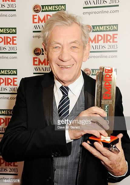 Sir Ian McKellen poses in the press room with the Best Science Fiction/Fantasy award for 'The Hobbit' at the Jameson Empire Awards 2013 at The...