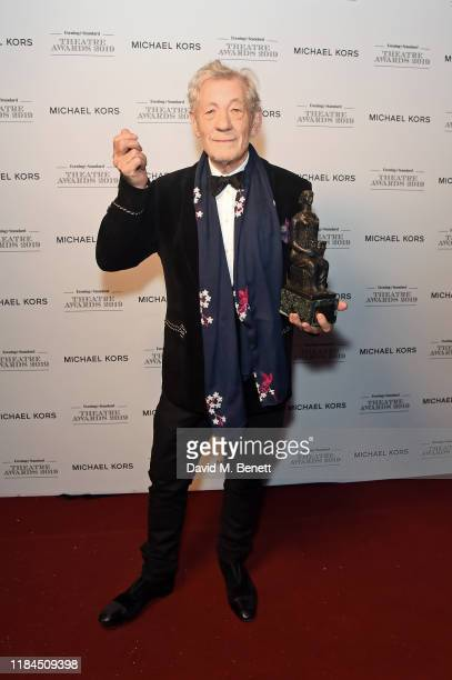 Sir Ian McKellen winner of the Editors Award poses in the winners room at the 65th Evening Standard Theatre Awards In Association With Michael Kors...