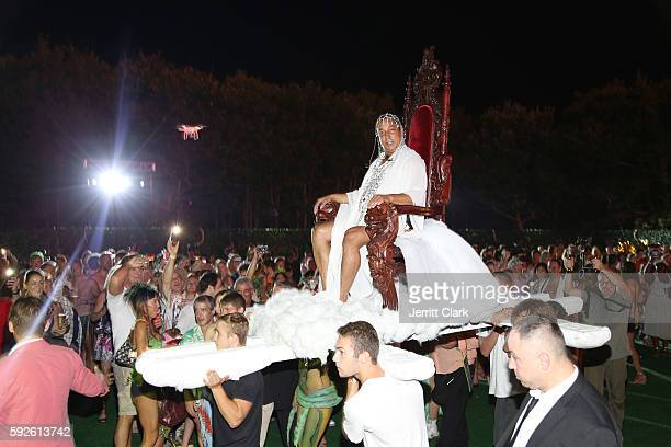 Sir Ivan is carried on a throne during his Sinful 60th Birthday Imagine Record Release Party at Sir Ivan's Castle on August 20 2016 in Water Mill New...