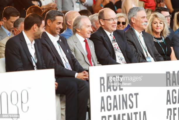 Sir Jackie Stewart, Albert II, Prince of Monaco, and Chase Carey attend the Amber Lounge Fashion Monaco 2017 at Le Meridien Beach Plaza Hotel on May...