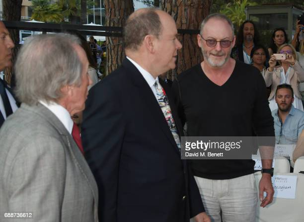 Sir Jackie Stewart, Albert II, Prince of Monaco, and Liam Cunningham attend the Amber Lounge Fashion Monaco 2017 at Le Meridien Beach Plaza Hotel on...