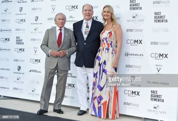 Sir Jackie Stewart, Albert II, Prince of Monaco, and Sonia Irvine attend the Amber Lounge Fashion Monaco 2017 at Le Meridien Beach Plaza Hotel on May...