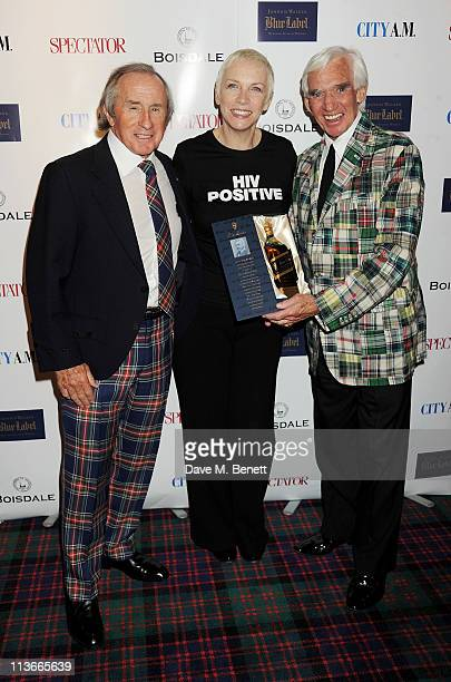 Sir Jackie Stewart Annie Lennox and Bill Martin pose at the Johnny Walker Blue Label Great Scot Awards 2011 at Boisdale of Canary Wharf on May 4 2011...