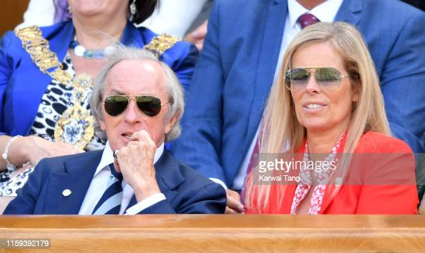 Sir Jackie Stewart with his wife Helen Stewart attend day 1 of the Wimbledon Tennis Championships at the All England Lawn Tennis and Croquet Club on...