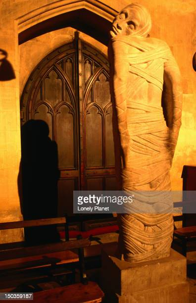 sir jacob epstein's somewhat distrurbing statue of lazarus in the chapel of new college - epstein statue stock pictures, royalty-free photos & images