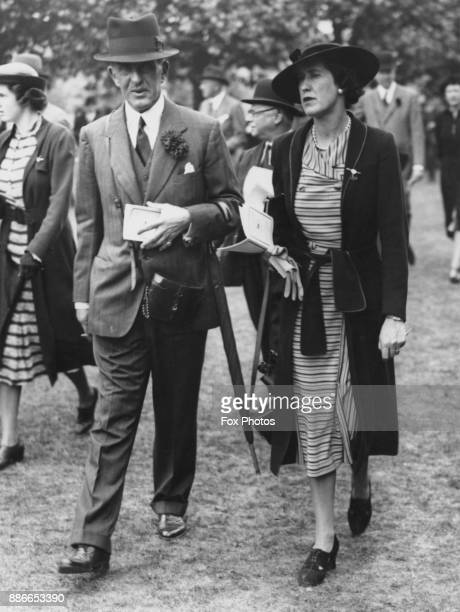 Sir Jock Delves Broughton with Dorothy Marchioness of Cambridge during the Eclipse Meeting at Sandown Park UK 15th July 1938