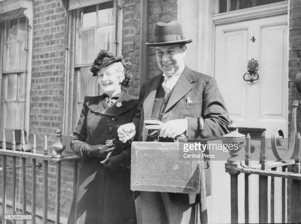 Sir John Anderson Chancellor of the Exchequer with his wife carrying the historic red briefcase containing the government Budget London April 25th...