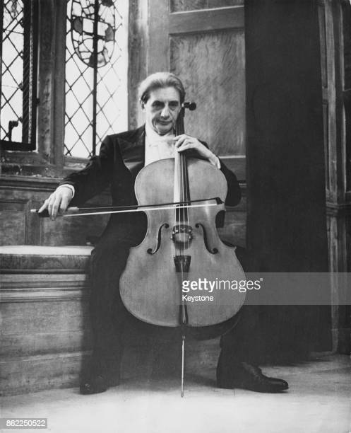 Sir John Barbirolli plays the cello with the King's Lynn Festival Ensemble, during a charity performance at Sutton Place, home of millionaire Paul...
