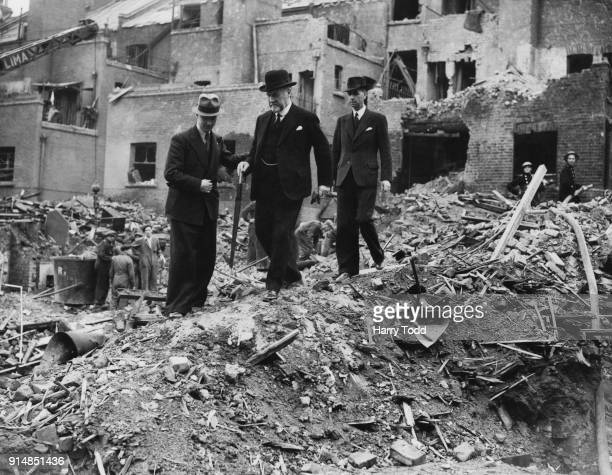 Sir John Dawson Laurie the Lord Mayor of London views a bombdamaged site in Elephant and Castle London accompanied by Albert Joseph Gates the Mayor...