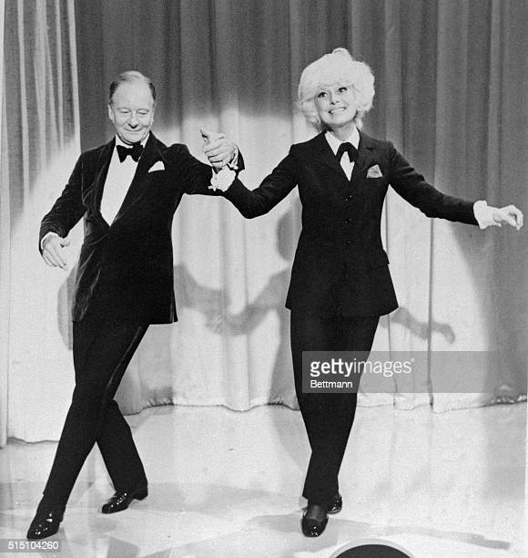 Sir John Gielgud may not feel quite at home kicking up his heels with Carol Channing as he does performing in a Shakespearean play but he does quite...