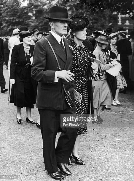 Sir John Henry 'Jock' Delves Broughton, the 11th Baronet of Doddington and Lady Delves Broughton attend the Sandown Park races, 14th July 1939.