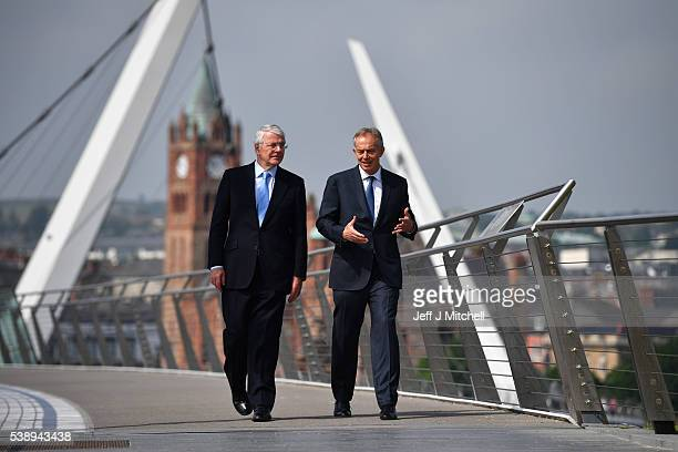 Sir John Major and Tony Blair speak as they walk across the Peace Bridge on June 9 2016 in Derry Northern Ireland Former British Prime Ministers Sir...