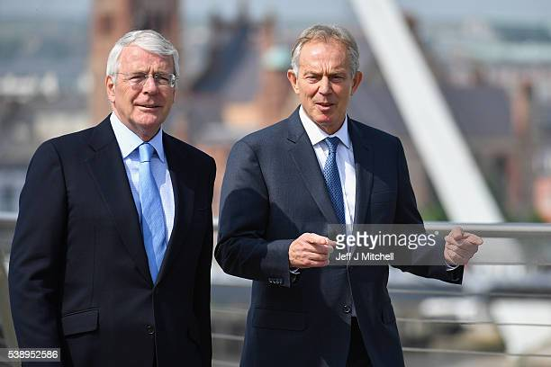 Sir John Major and Tony Blair speak as they walk across the Peace Bridge on June 9, 2016 in Derry, Northern Ireland. Former Prime Ministers Sir John...