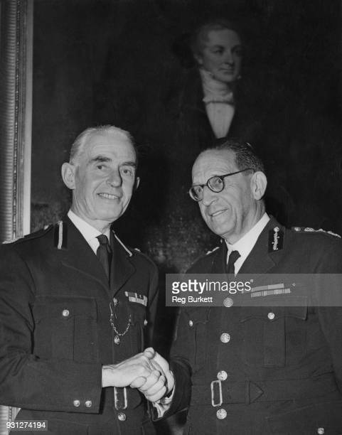 Sir John NottBower is congratulated by Sir Harold Scott at Scotland Yard in London upon his appointment as Deputy Commissioner of the Metropolitan...
