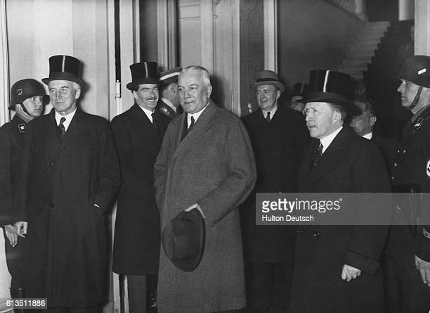 Sir John Simon Antony Eden the German Foreign Minister Baron von Neurath and Sir Eric Phipps the British Ambassador after talks on Hitler's plan to...