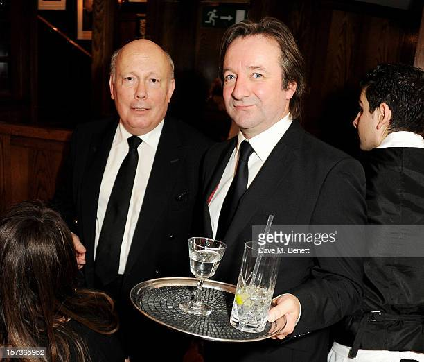 Sir Julian Fellowes working as a waiter and actor Neil Pearson working as Maitre d' attend One Night Only at The Ivy featuring 30 stage and screen...