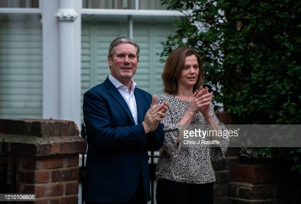 Sir Keir Starmer, leader of the Labour Party, claps outside his home with his wife Victoria Starmer as part of the Clap For Our Carers campaign on...