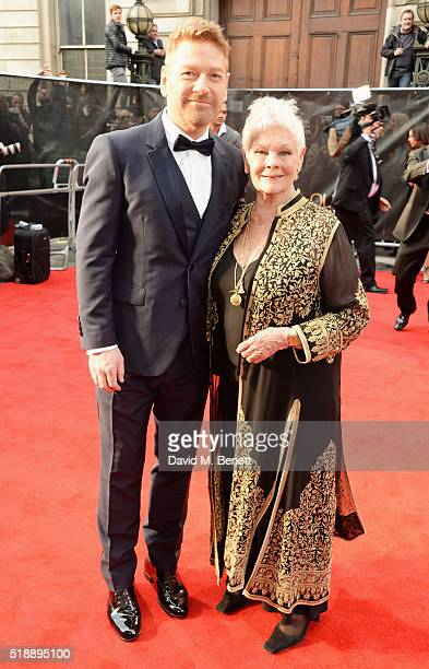 Sir Kenneth Branagh and Dame Judi Dench arrive at The Olivier Awards with Mastercard at The Royal Opera House on April 3 2016 in London England