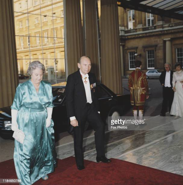 Sir Kenneth Newman , Commissioner of the Metropolitan Police, attends a dinner at Buckingham Palace in London with his wife Eileen, 1st July 1986....