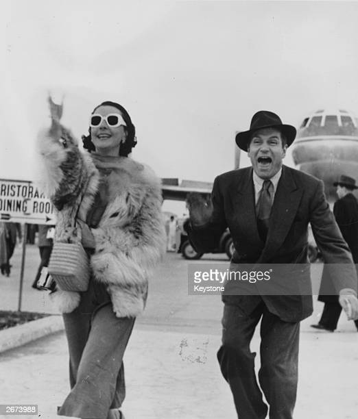 Sir Laurence Olivier and his wife Vivien Leigh arriving at Rome airport
