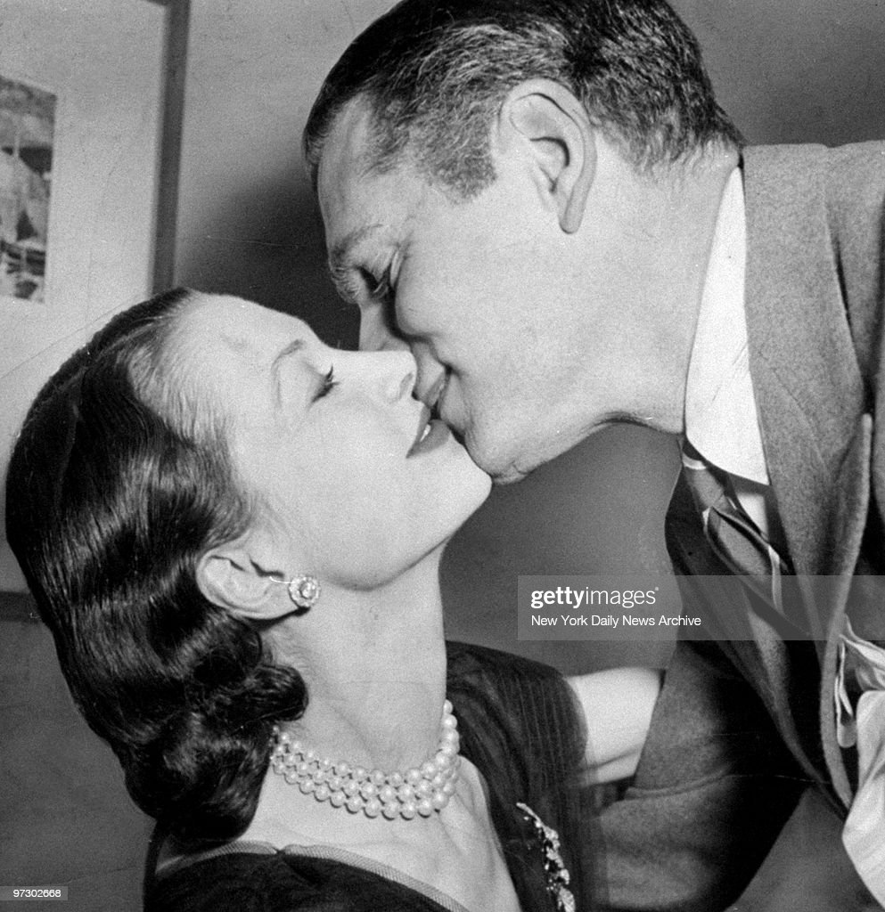 Sir Laurence Olivier plants a kiss on wife Vivien Leigh in her New York theater dressing room after learning she won an Oscar for best actress for her role in 'A Streetcar Named Desire.'