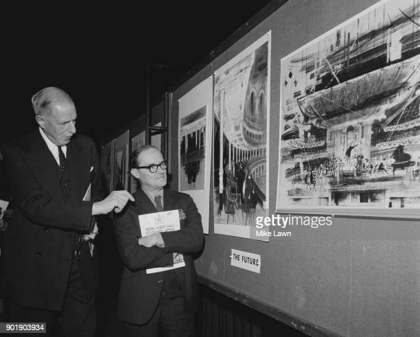 Sir Louis Gluckstein discusses the proposed redecoration of the Royal Albert Hall with architect Sir Hugh Casson at a press conference in London 12th...