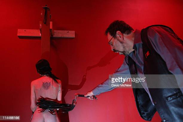 Sir MAL whips Gina Burghard at an offsite dungeon party during the 8th annual DomCon LA convention on May 20 2011 in Los Angeles California The...