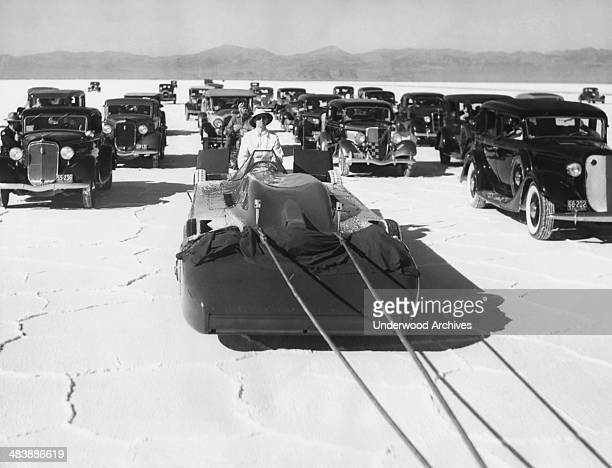 Sir Malcolm Campbell's Bluebird race car is towed out to the salt beds for its first test run in his attempt to set a new automobile speed record of...