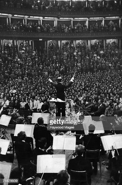 Sir Malcolm Sargent leads the BBC Symphony Orchestra in a rendition of the National Anthem at the Royal Albert Hall in London during the Last Night...