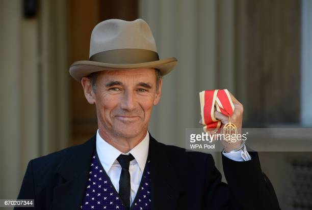 Sir Mark Rylance poses after he was knighted by the Duke of Cambridge during an investiture ceremony at Buckingham Palace on April 19 2017 in London...